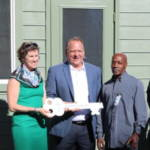 DACG Passes Key to Helping Up Mission for New Welcome Booth